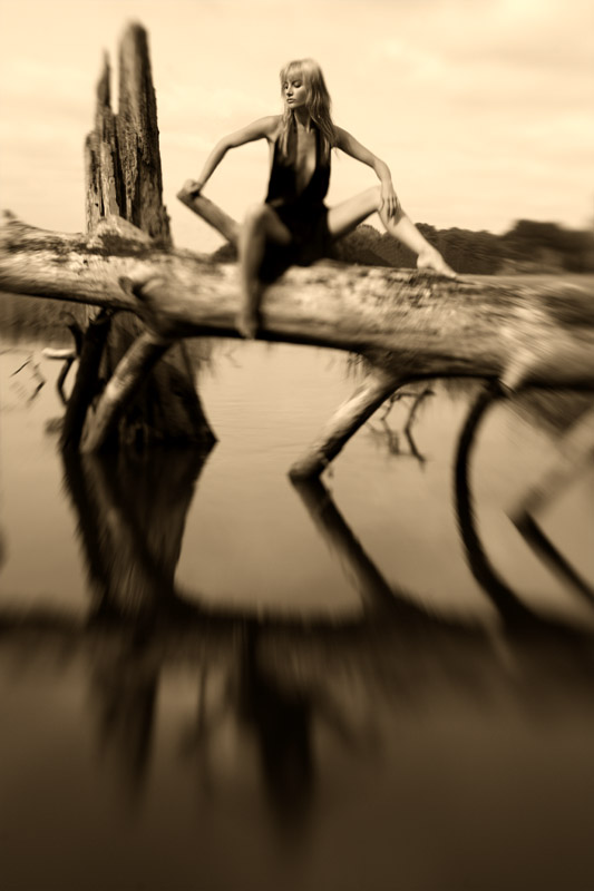 Girl on a log; Seashore Sepia