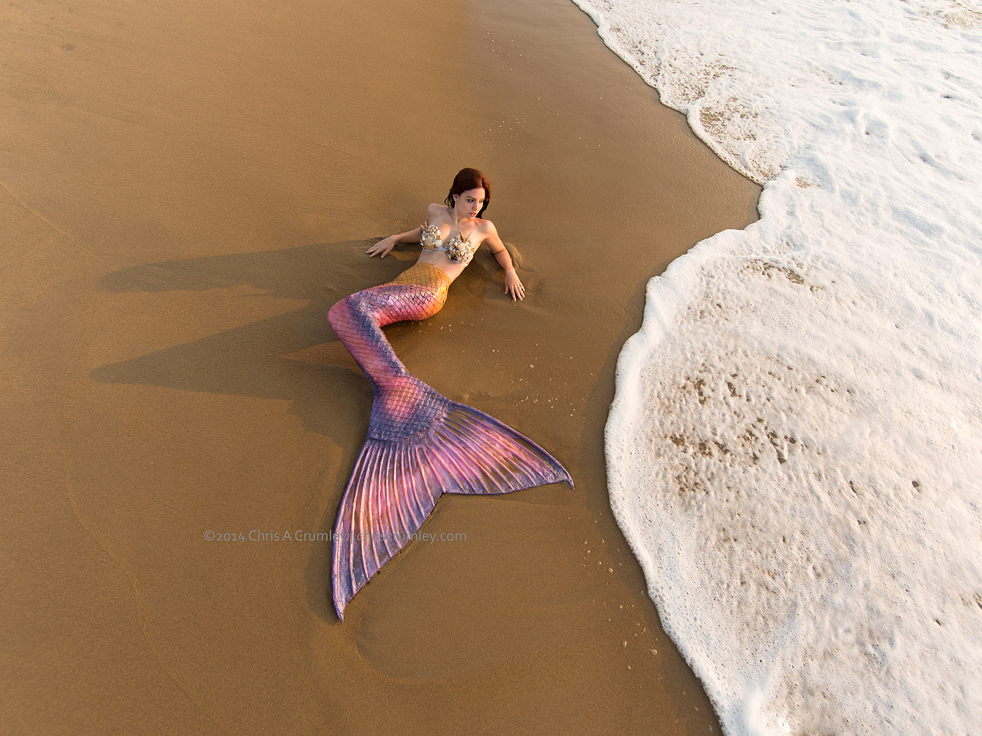 Mermaid on the beach at sunrise, Virginia Beach, VA