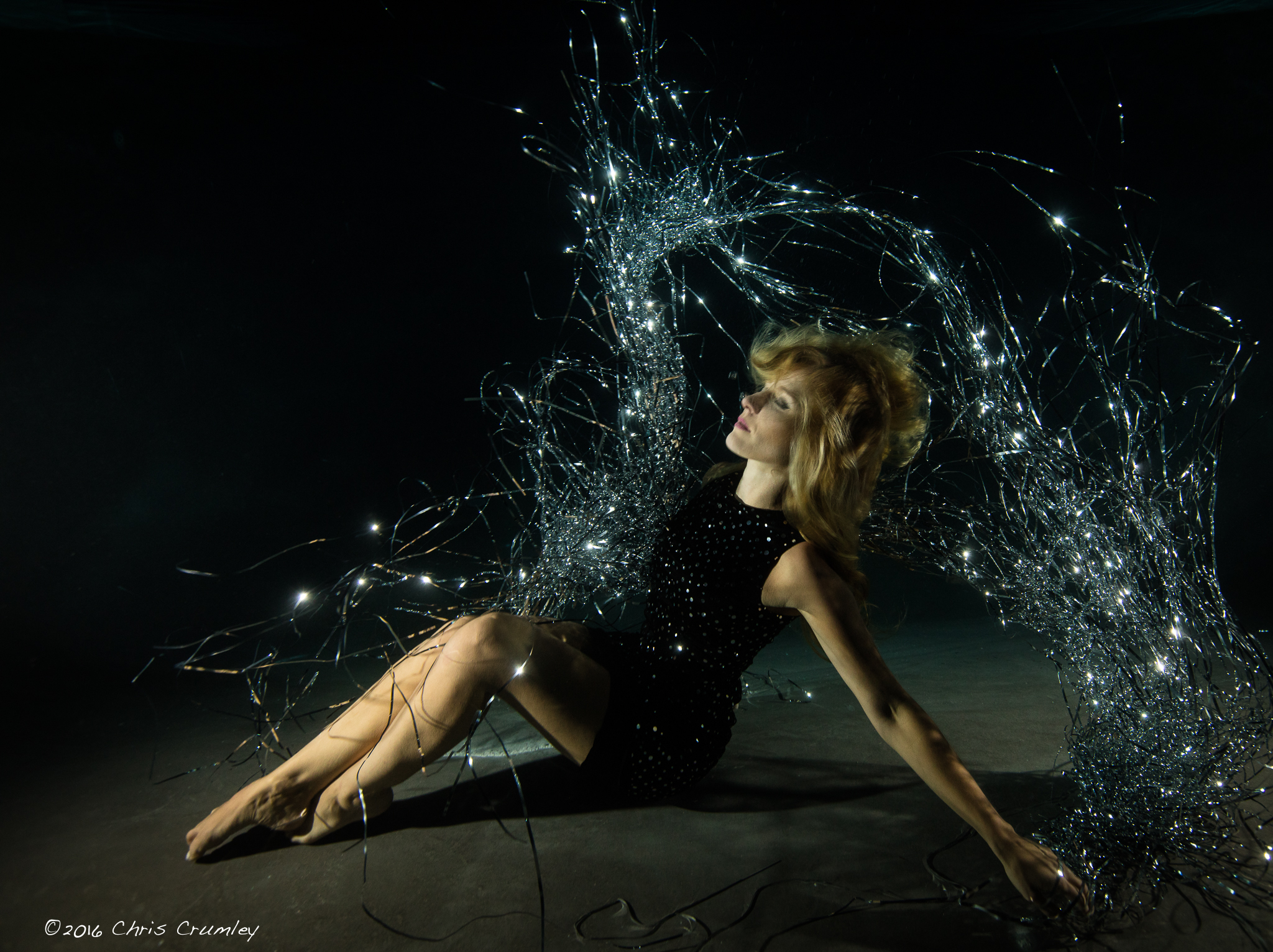 Kristi Sherk in black dress underwater