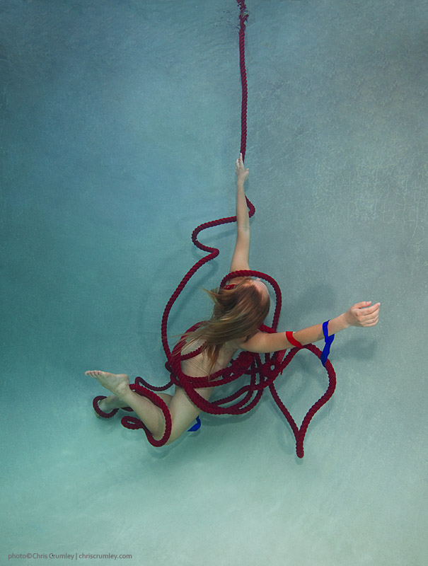 Underwater Dance on a red rope