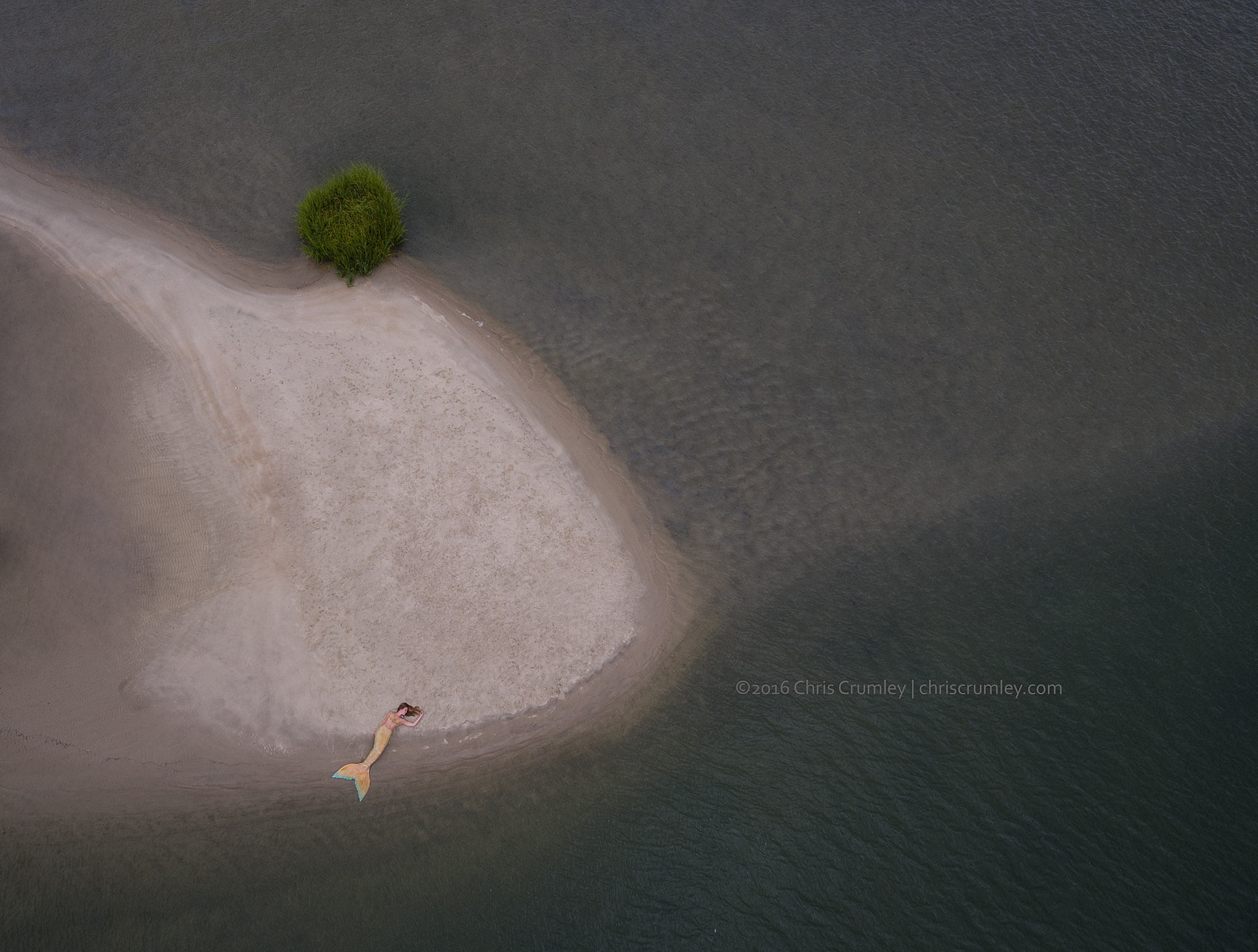 Aerial of a mermaid on sandbar in Virginia Beach, VA